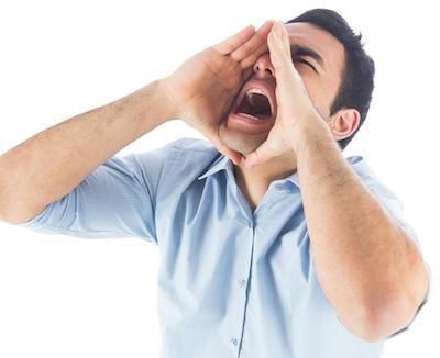 Man in blue shirt shouting